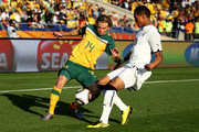 Brett Holman of Australia controls the ball as Kevin Prince Boateng of Ghana closes him down during the 2010 FIFA World Cup South Africa Group D match between Ghana and Australia at the Royal Bafokeng Stadium on June 19, 2010 in Rustenburg, South Africa.