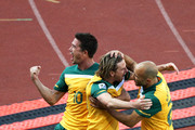 Brett Holman of Australia celebrates scoring the opening goal with Harry Kewell (L) and Marco Bresciano (R) during the 2010 FIFA World Cup South Africa Group D match between Ghana and Australia at the Royal Bafokeng Stadium on June 19, 2010 in Rustenburg, South Africa.