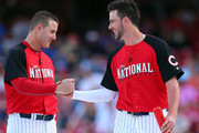 National League All-Star Anthony Rizzo #44 of the Chicago Cubs high-fives National League All-Star Kris Bryant #17 of the Chicago Cubs during the Gillette Home Run Derby presented by Head & Shoulders at the Great American Ball Park on July 13, 2015 in Cincinnati, Ohio.