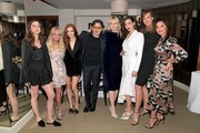 (L-R) Ana de Armas, Kristin Chenoweth, Madeline Brewer, Giovanni Morelli, Laura Brown, Emmy Rossum, Allison Janney, and Olivia Munn attend the Opening of Beverly Hills Boutique with a private VIP dinner hosted by Giovanni Morelli, Stuart Weitzman Creative Director, and Laura Brown, InStyle Editor-In-Chief at The Sunset Tower Hotel on January 19, 2018 in Los Angeles, California.