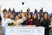 """Emmanuelle Bercot, Evin Ahmad,  Golshifteh Farahani, Eva Husson, Mari Samidovi, Sinama Alievi and Roza Mirzoiani attend the photocall for """"Girls Of The Sun (Les Filles Du Soleil)"""" during the 71st annual Cannes Film Festival at Palais des Festivals on May 13, 2018 in Cannes, France."""