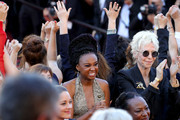 """Tonie Marshall (R) and filmmakers clap on the steps in protest of the lack of female filmmakers honored throughout the history of the festival at the screening of """"Girls Of The Sun (Les Filles Du Soleil)"""" during the 71st annual Cannes Film Festival at the Palais des Festivals on May 12, 2018 in Cannes, France. Only 82 films in competition in the official selection have been directed by women since the inception of the Cannes Film Festival whereas 1,645 films in the past 71 years have been directed by men."""