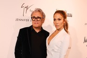 Jennifer Lopez And Giuseppe Zanotti arrive to promote their new shoe collaboration at the Neiman Marcus store in Beverly Hills, California on January 26, 2017. / AFP / Mark RALSTON