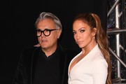 Actress Jennifer Lopez And Giuseppe Zanotti arrive to promote their new shoe collaboration at the Neiman Marcus store in Beverly Hills, California on January 26, 2017. / AFP / Mark RALSTON