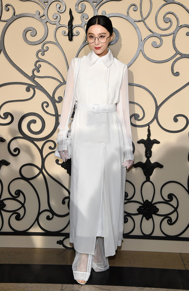Fan Bingbing made a chic arrival at the Givenchy Spring 2018 show in a sheer-sleeve white trenchcoat from the brand.
