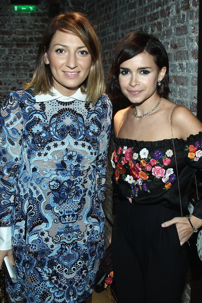 Miroslava Duma (R) and Asya Mhitarian attend the Glamour dinner for Patrick Demarchelier as part of the Paris Fashion Week Womenswear  Spring/Summer 2014 at Monsieur Bleu restaurant on September 29, 2013 in Paris, France.