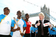 (EDITORIAL USE ONLY, NO SALES)  In this handout image provided by Glasgow 2014 Ltd, (L-R) Michael Pusey, Faramolu Johnson, Olympic gold medalist Christine Ohurugu and Mayor of London Boris Johnson pose with Queen's Baton as it arrives in London on June 06, 2014 in London, England. England is nation 69 of 70 nations and territories the Queen's Baton will visit.