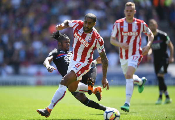 Stoke City vs. Crystal Palace - Premier League [player,sports,tournament,sports equipment,sport venue,football player,team sport,football,ball game,soccer player,wilfried zaha,glen johnson,crystal palace,stoke on trent,england,bet365 stadium,stoke city,premier league,match]