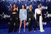 (L-R) Jesy Nelson, Jade Thirlwall, Perrie Edwards and Leigh-Anne Pinnock of Little Mix attend The Global Awards 2018 at Eventim Apollo, Hammersmith on March 1, 2018 in London, England.