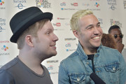 Musicians Patrick Stump and Peter Wentz of Fall Out Boy pose backstage during Global Citizen 2015 Earth Day on National Mall to end extreme poverty and solve climate change on April 18, 2015 in Washington, DC.