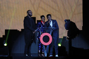 Tyler Perry, Ivy McGregor and Steve Pamon speak on stage during the Global Citizen Festival: Mandela 100 at FNB Stadium on December 2, 2018 in Johannesburg, South Africa.