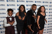 L-R Wendel Hutchins II, Aaniya Hutchins, Jamie Foxx and Analise Foxx on the red carpet at the Global Down Syndrome 10th anniversary BBBY fashion show at Sheraton Denver Downtown Hotel on October 20, 2018 in Denver, Colorado.