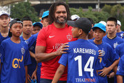 Christian Karembeu poses with a child at the Global Legends Series coaching clinic, at the Thailand Sports Authority, on December 4, 2014 in Bangkok, Thailand.