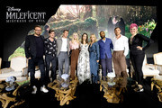 """(L-R) Director Joachim Ronning, actors Sam Riley, Harris Dickinson, Elle Fanning, Angelina Jolie, Michelle Pfeiffer, Chiwetel Ejiofor, Ed Skrein and moderator Grae Drake participate in the global press conference for """"Disney's Maleficent: Mistress of Evil"""" on September 30, 2019 in Beverly Hills, California."""
