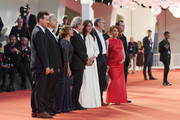 "Gregoire Leprince-Ringuet ,  Gerard Meylan, Ariane Ascaride,  Robert Guediguian, Anais Demoustier, Jean-Pierre Darroussin,  Lola Naymark  and  Robinson Stevenin walk the red carpet ahead of the ""Gloria Mundi"" screening during the 76th Venice Film Festival at Sala Grande on September 05, 2019 in Venice, Italy."