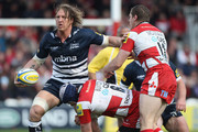 Andy Powell (L) of Sale looks to offload as Peter Buxton (C) and Tim Molenaar (R) challenge during the Aviva Premiership match between Gloucester and Sale Sharks at Kingsholm Stadium on April 21, 2012 in Gloucester, England.