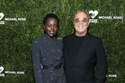 Lupita Nyong'o and Michael Kors attend God's Love We Deliver 13th Annual Golden Heart Awards celebration at Cipriani South Street on October 21, 2019 in New York City.