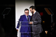 Nathan Lane and  Tony Kushner appear onstage at God's Love We Deliver, Golden Heart Awards at Spring Studios on October 16, 2018 in New York City.