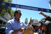 California Lt. Gov. Gavin Newsom greets Golden State Warriors fans during the Golden State Warriors Victory Parade on June 12, 2018 in Oakland, California. The Golden State Warriors beat the Cleveland Cavaliers 4-0 to win the 2018 NBA Finals. NOTE TO USER: User expressly acknowledges and agrees that, by downloading and/or using this photograph, user is consenting to the terms and conditions of the Getty Images License Agreement.