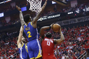 James Harden #13 of the Houston Rockets drives to the baskeet as Jordan Bell #2 of the Golden State Warriors and Klay Thompson #1 defend  during Game Six of the Western Conference Semifinals of the 2019 NBA Playoffs at Toyota Center on May 10, 2019 in Houston, Texas. NOTE TO USER: User expressly acknowledges and agrees that, by downloading and or using this photograph, User is consenting to the terms and conditions of the Getty Images License Agreement.