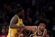 Quinn Cook #2 of the Los Angeles Lakers drives on Draymond Green #23 of the Golden State Warriors during a 120-94 Lakers win at Staples Center on November 13, 2019 in Los Angeles, California.  NOTE TO USER: User expressly acknowledges and agrees that, by downloading and/or using this photograph, user is consenting to the terms and conditions of the Getty Images License Agreement.