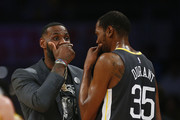 LeBron James #23 of the Los Angeles Lakers speaks to Kevin Durant #35 of the Golden State Warriors during a timeout in the first half at Staples Center on April 04, 2019 in Los Angeles, California. NOTE TO USER: User expressly acknowledges and agrees that, by downloading and or using this photograph, User is consenting to the terms and conditions of the Getty Images License Agreement.