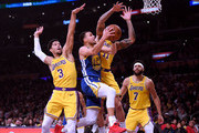 Stephen Curry #30 of the Golden State Warriors drives to the basket past Josh Hart #3 and Michael Beasley #11 of the Los Angeles Lakers during the first half at Staples Center on January 21, 2019 in Los Angeles, California.  NOTE TO USER: User expressly acknowledges and agrees that, by downloading and or using this photograph, User is consenting to the terms and conditions of the Getty Images License Agreement.