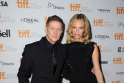 """Director Andrew Niccol (L) and  Rachel Roberts attend the """"Good Kill"""" premiere during the 2014 Toronto International Film Festival at Ryerson Theatre on September 9, 2014 in Toronto, Canada."""