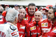 Giacomo Agostini of Italy speaks with Pedro de la Rosa of Spain and the Ferrari F1 team during the Goodwood Festival of Speed at Goodwood House on June 28, 2014 in Chichester, England.