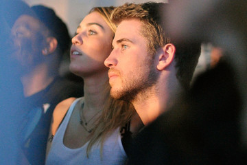 Miley Cyrus Liam Hemsworth Google And T-Mobile Celebrate The Launch Of Google Music At Mr. Brainwash Studio In Los Angeles - Inside
