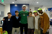 Gordon Hayward takes a photo with (L to R) Roy, Ben, Nicholas, Jonah, and Doneal after playing video games for Extra Life at Boston Children's Hospital November 2, 2019 in Boston, Massachusetts.