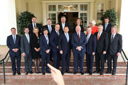 The new Abbott Ministry getting ready to pose for media with Prime Minister Tony Abbott and Governor-General Peter Cosgrove at Government House on December 23, 2014 in Canberra, Australia. Australian Prime Minister Tony Abbott today announced his first ministerial reshuffle to Governor-General Sir Peter Cosgrove.