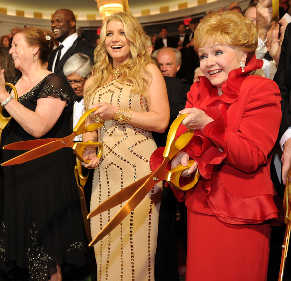 Jessica Simpson Jessica Simpson and Debbie Reynolds participate in the ribbon cutting at the grand opening of the Casino Club at The Greenbrier on July 2, 2010 in White Sulphur Springs, West Virginia.