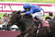 Oisin Murphy riding Royal Marine (blue) win The Qatar Prix Jean-luc Lagardere from Broome and Ryan Moore (farside) during the Grand Prix de l'Arc de Triomphe at Hippodrome de Longchamp on October 7, 2018 in Paris, France.