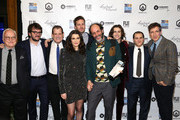 """Director Luca Guadagnino and actress Rachel Weisz pose with the cast of """"Call Me By Yout Name"""" with their award for Best Feature Film at the 2017 Gotham Awards sponsored by Greater Ft. Lauderdale Tourism at Cipriani, Wall Street on November 27, 2017 in New York City."""