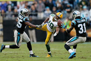 Bene' Benwikere #25 and teammate Charles Tillman #31 of the Carolina Panthers defend a pass to Randall Cobb #18 of the Green Bay Packers in the 4th quarter during their game at Bank of America Stadium on November 8, 2015 in Charlotte, North Carolina.
