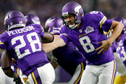 Quarterback Sam Bradford #8 of the Minnesota Vikings hands off to running back Adrian Peterson #28 during the game against the Green Bay Packers on September 18, 2016 in Minneapolis, Minnesota.