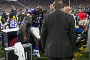 Adrian Peterson #28 of the Minnesota Vikings is carried into the locker room after injuring his knee in the third quarter of their game against the Green Bay Packers on September 18, 2016 at US Bank Stadium in Minneapolis, Minnesota.
