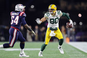 Dont'a Hightower #54 of the New England Patriots attempts to tackle Jimmy Graham #80 of the Green Bay Packers during the first half at Gillette Stadium on November 4, 2018 in Foxborough, Massachusetts.
