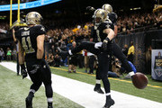 Jimmy Graham #80 of the New Orleans Saints celebrates with his teammates after a touchdown in the seocond quarter against the Green Bay Packers at Mercedes-Benz Superdome on October 26, 2014 in New Orleans, Louisiana.