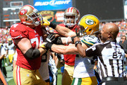 Clay Matthews #52 of the Green Bay Packers and Joe Staley #74 of the San Francisco 49ers gets into a fight after Matthews hit quarterback Colin Kaepernick #7 late out of bounds during the second quarter at Candlestick Park on September 8, 2013 in San Francisco, California.