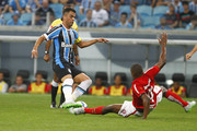 PORTO ALEGRE, BRAZIL AUGUST 09: Maicon of Gremio battles for the ball against Juan of Internacional during the match Gremio v Internaciona as part of Brasileirao Series A 2015, at Arena do Gremio on August 9, 2015 in Porto Alegre, Brazil.