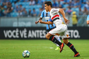 Arthur of Gremio battles for the ball against Hernanes of Sao Paulo during the match between Gremio and Sao Paulo as part of the Brasileirao Series A 2017, at Arena do Gremio on November 14, 2017, in Porto Alegre, Brazil.