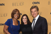 """Gayle King (L), Surgeon, author Dr. Mehmet Oz and Lisa Oz  attends the """"Belief"""" New York premiere at TheTimesCenter on October 14, 2015 in New York City."""