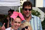 Singer Miley Cyrus, President of the ALS Association Golden West chapter Fred Fisher and  Mari Wilson attend the 13th Annual LA County Walk To Defeat ALS at Exposition Park on October 18, 2015 in Los Angeles, California.