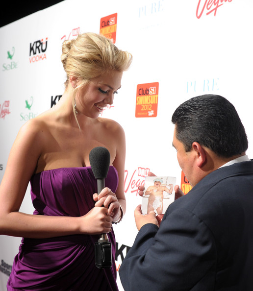 Club SI Swimsuit Hosted By PURE Nightclub At Caesars Palace [hairstyle,dress,event,blond,magenta,premiere,carpet,photography,flooring,microphone,kate upton,guillermo rodriguez,club si swimsuit,caesars palace,las vegas,nevada,pure nightclub,pure nightclub,sports illustrated swimsuit issue]