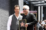(L-R) Matthew McConaughey with Chef Guy Fieri who was honored with the 2,664th Star on the Hollywood Walk of Fame Star, in Hollywood, California.