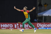 In this handout image provided by CPL T20, Imran Tahir of Guyana Amazon Warriors celebrates the dismissal of David Warner of St Lucia Stars during match 4 of the Hero Caribbean Premier League between Guyana Amazon Warriors and St Lucia Stars at Guyana National Stadium on August 11, 2018 in Providence, Guyana.