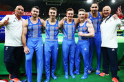 Team Great Britain (L-R) coach  Eddie Van Hoof, Kristian Thomas, Max Whitlock, Brinn Bevan, Nile Wilson and Louis Smith pose for a photo after Artistic Gymnastics Men's Team qualification on Day 1 of the Rio 2016 Olympic Games at Rio Olympic Arena on August 6, 2016 in Rio de Janeiro, Brazil.