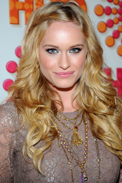 At the HBO Emmy Awards post award reception, Leven Rambin wore a cool gold medallion necklace with beading.